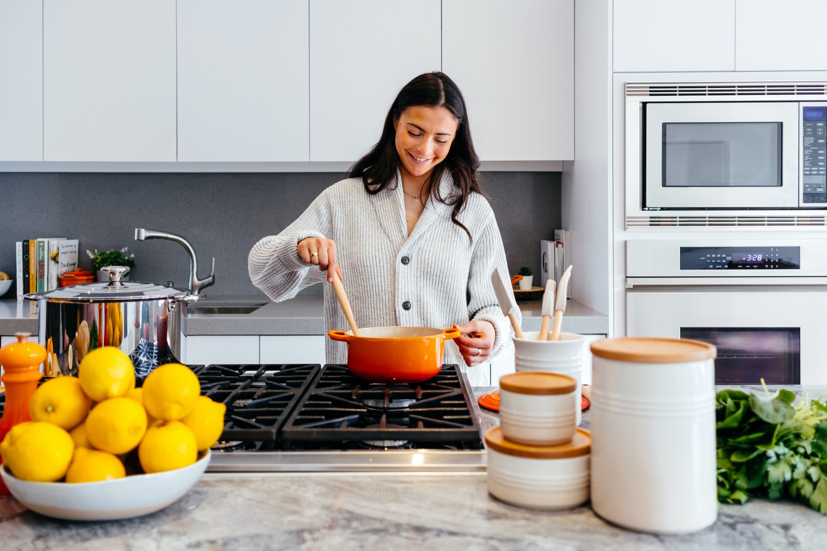 woman cooking in the kitchen - meal prep and healthy eating