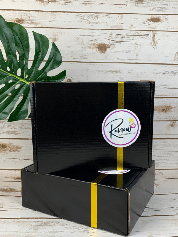 renew box sitting beside gold holiday ornaments